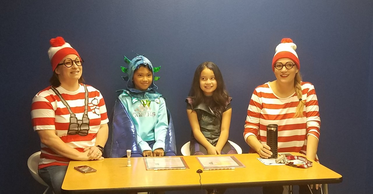 Teachers and students in costumes